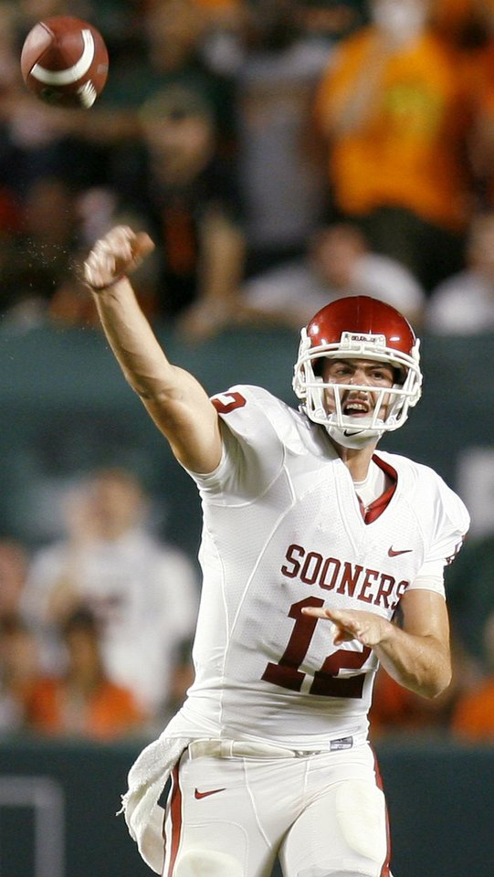 Photo - OU's Landry Jones passes the ball during the college football game between the University of Oklahoma (OU) Sooners and the University of Miami (UM) Hurricanes at Land Shark Stadium in Miami Gardens, Florida, Saturday, October 3, 2009. Photo by Bryan Terry, The Oklahoman