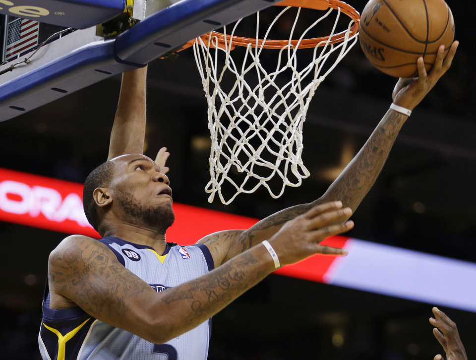 Photo - Memphis Grizzlies' Merreese Speights lays up a shot against the Golden State Warriors during the first half of an NBA basketball game, Wednesday, Jan. 9, 2013, in Oakland, Calif. (AP Photo/Ben Margot)