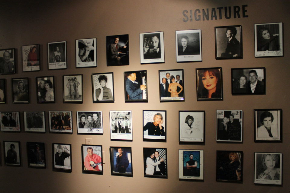 "Photo - The ""Signature"" room at Gallery Grazioso features dozens of framed photos of music stars. Photo by Heather Warlick, The Oklahoman."