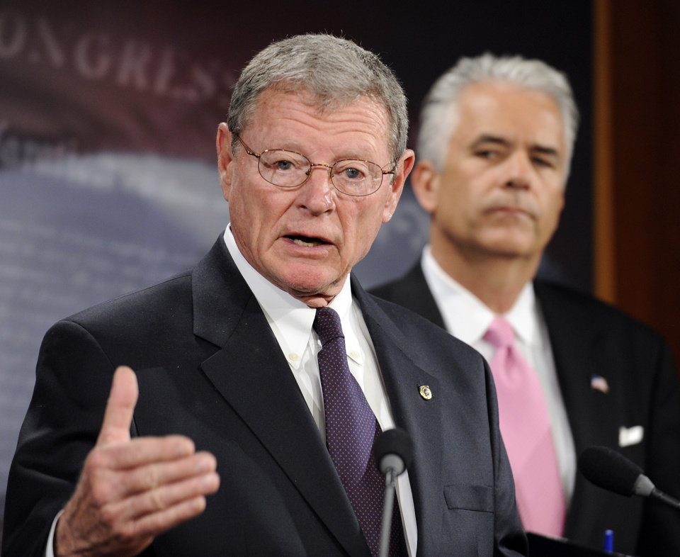 JIM INHOFE: Sen. John Ensign, R-Nev. looks on at right, as Sen. James Inhofe, R-Okla., speaks during a news conference to discuss TARP, Wednesday, April 22, 2009, on Capitol Hill in Washington. (AP Photo/Susan Walsh) ORG XMIT: DCSW115