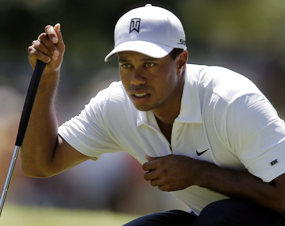 Tiger Woods lines up his putt on the third hole during the second round of the 2007 PGA Championship at Southern Hills Country Club on Friday, Aug. 10, 2007, in Tulsa, Okla. By CHRIS LANDSBERGER, The Oklahoman