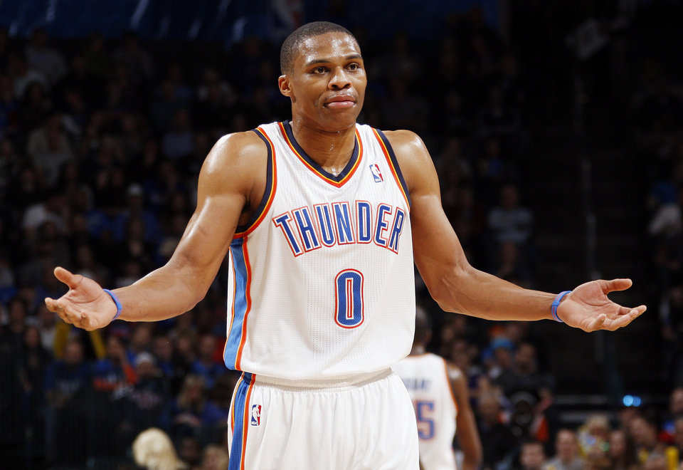 Photo - REACTION: Oklahoma City's Russell Westbrook (0) reacts after being called for an offensive foul in the third quarter during the NBA basketball game between the Oklahoma City Thunder and Phoenix Suns at Chesapeake Energy Arena in Oklahoma City, Saturday, Dec. 31, 2011. Oklahoma City won, 107-97. Photo by Nate Billings, The Oklahoman