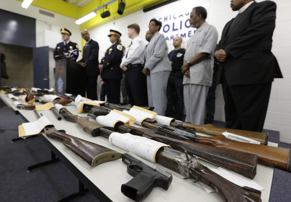Photo - Chicago Police First Deputy Superintendent Alfonsa Wysinger, second from left, accompanied by Deputy Chief Wayne Gulliford, left, speaks at a news conference Monday, Jan. 28, 2013, in Chicago. The pair joined other officers, elected officials, clergy, and community members, with a display of recently recovered firearms from the 574 seized to date beginning Jan. 1, 2013. (AP Photo/M. Spencer Green)