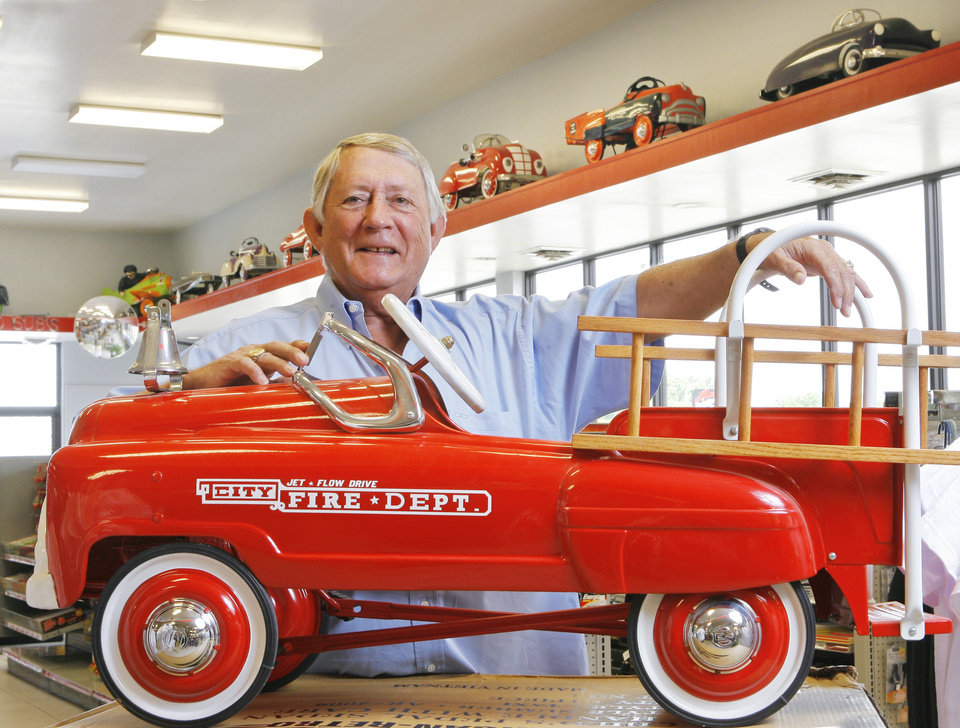 Photo - Ed Stites with his metal pedal cars in Ed's Truck Stop in Sallisaw, Thursday, June 21, 2007.  BY DAVID MCDANIEL, THE OKLAHOMAN. ORG XMIT: KOD