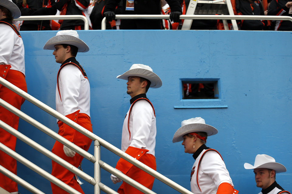 Photo - The OSU make their way to their seats before the Heart of Dallas Bowl football game between the Oklahoma State University (OSU) and Purdue University at the Cotton Bowl in Dallas,  Tuesday,Jan. 1, 2013. Photo by Sarah Phipps, The Oklahoman