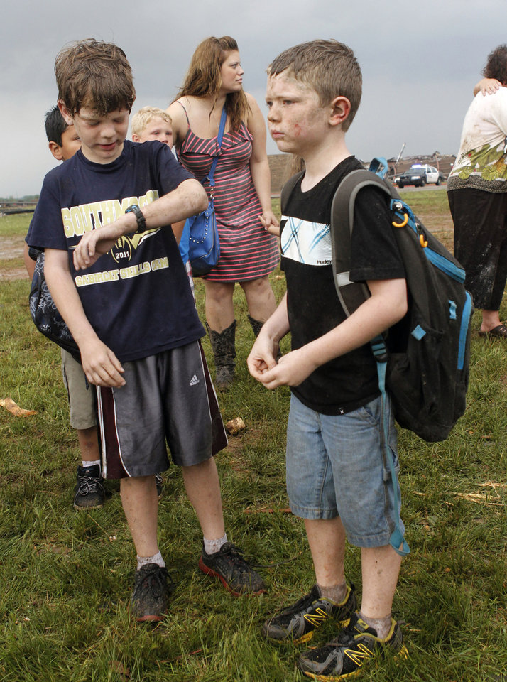 Zachary Harris, left, and his brother Matthew wait together for their parents to arrive at Briarwood Elementary school after a tornado destroyed the school in south OKC Oklahoma City, OK, Monday, May 20, 2013. Near SW 149th and Hudson.  By Paul Hellstern, The Oklahoman