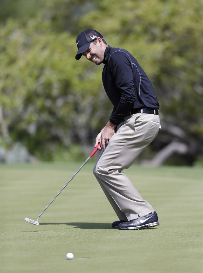 Charl Schwartzel, of South Africa, reacts to missing a birdie putt on the sixth hole during the second round of the Texas Open golf tournament, Friday, April 5, 2013, in San Antonio.  (AP Photo/Eric Gay)