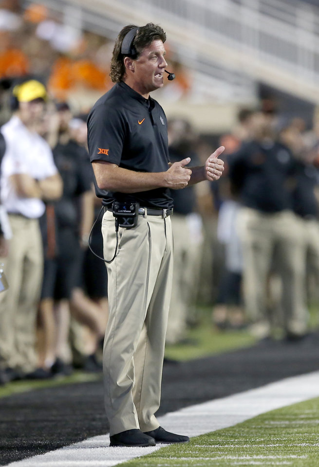 Photo - Oklahoma State head coach Mike Gundy talks on the head set in the third quarter during a college football game between Oklahoma State (OSU) and South Alabama at Boone Pickens Stadium in Stillwater, Okla., Saturday, Sept. 8, 2018. Photo by Sarah Phipps, The Oklahoman