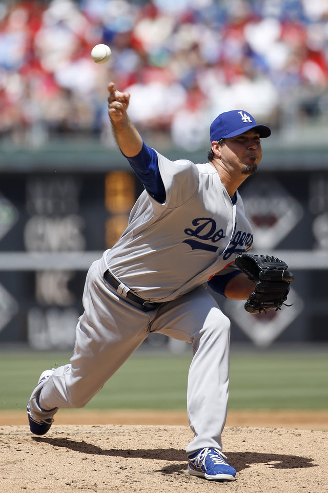 Photo - Los Angeles Dodgers' Josh Beckett pitches during the second inning of a baseball game against the Philadelphia Phillies, Sunday, May 25, 2014, in Philadelphia. (AP Photo/Matt Slocum)