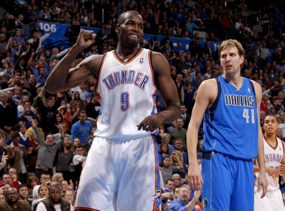 Oklahoma City's Serge Ibaka (9) reacts beside Dallas' Dirk Nowitzki (41) during an NBA basketball game between the Oklahoma City Thunder and the Dallas Mavericks at Chesapeake Energy Arena in Oklahoma City, Thursday, Dec. 27, 2012.  Oklahoma City won 111-105. Photo by Bryan Terry, The Oklahoman