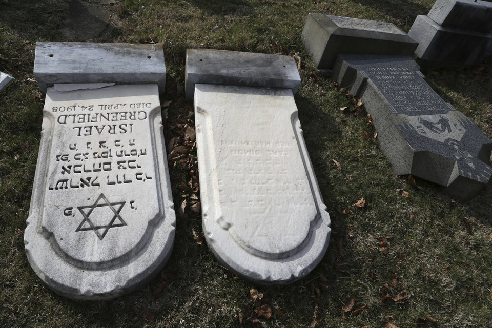 Photo - Damaged headstones are seen at Mount Carmel cemetery Monday, Feb. 27, 2017, in Philadelphia. More than 100 headstones have been vandalized at the Jewish cemetery in Philadelphia, damage discovered less than a week after similar vandalism in Missouri, authorities said.(AP Photo/Jacqueline Larma)