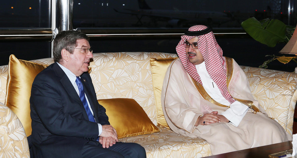 """Photo - This image released by the Saudi Press Agency shows Prince Nawaf Faisal Fahd bin Abdul-Aziz, an International Olympic Committee member and president of the national Olympic committee, right,, walking with IOC President Thomas Bach, left, in Riyadh, Saudi Arabia, Wednesday, April 2, 2014. IOC President Thomas Bach has discussed the issue of women's participation in sports with Saudi Arabia's Olympic chief. The IOC says Wednesday that Bach promised """"full support"""" for the country's sports development strategy through 2020. The plan includes """"proposals to increase women's participation in the Olympic Games and in sport in general."""" Saudi women are largely banned from participating in sports in the kingdom, although there are several football and basketball clubs that play in clandestine leagues. After prolonged negotiations with the IOC, Saudi Arabia sent women to the Olympics for the first time in 2012, with two female athletes competing at the London Games. (AP Photo/Saudi Press Agency)"""