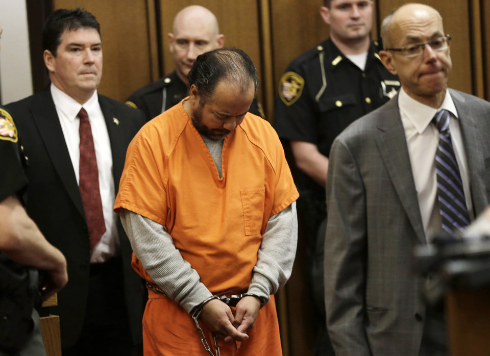 Ariel Castro, center, enters the courtroom for his arraignment Wednesday, June 12, 2013, in Cleveland. Castro, accused of holding three women captive in his Cleveland home for about a decade, pleaded not guilty Wednesday to hundreds of charges, including rape and kidnapping. He is charged with kidnapping three women and keeping them _ sometimes restrained in chains _ along with a 6-year-old girl he fathered with one of them. (AP Photo/Tony Dejak)