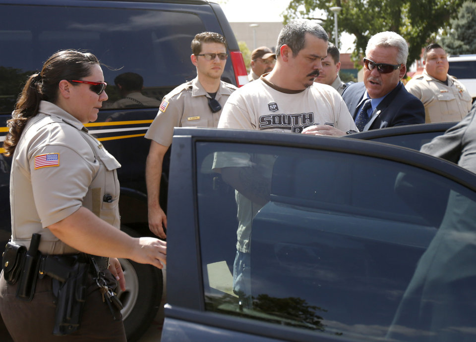 Photo - Shawn Caleb Galusha is led away from the Garfield County Courthouse in Enid, Okla., Tuesday, July 25, 2017, after being indicted in connection with the death of an inmate. Photo by Bryan Terry, The Oklahoman