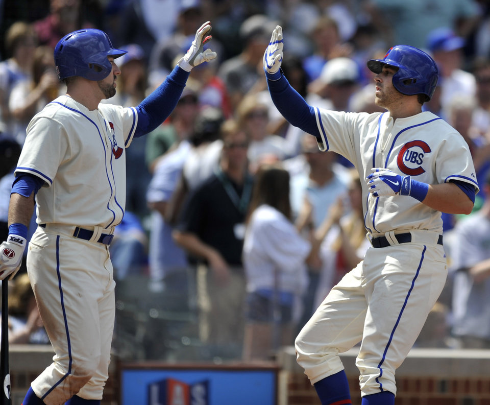 Photo - Chicago Cubs' MIke Olt, right, celebrates with teammate Ryan Kalish left, at home plate after hitting a solo home run during the fourth inning of a baseball game against the Milwaukee Brewers in Chicago, Sunday, May 18, 2014. Chicago won 4-2. (AP Photo/Paul Beaty)
