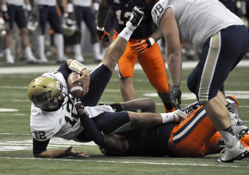 Photo -   Pittsburgh quarterback Tino Sunseri is sacked by Syracuse's Brandon Sharpe during the first quarter of an NCAA college football game in Syracuse, N.Y., Friday, Oct. 5, 2012. (AP Photo/Kevin Rivoli)