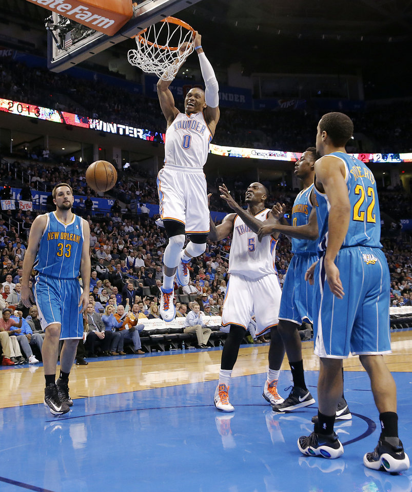 Photo - Oklahoma City Thunder's Russell Westbrook (0) dunks the ball in front of New Orleans Hornets' Ryan Anderson (33) Al-Farouq Aminu (0) and Brian Roberts (22) during the NBA basketball game between the Oklahoma City Thunder and the New Orleans Hornets at the Chesapeake Energy Arena on Wednesday, Feb. 27, 2013, in Oklahoma City, Okla. Photo by Chris Landsberger, The Oklahoman