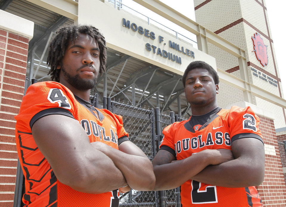 Photo - Douglass High School defensive ends D.J. Ward, left, and Deondre Clark stand in front of the gate of Moses F. Miller Stadium at Douglass High School inOklahoma City, OK, Friday, August 17, 2012,  By Paul Hellstern, The Oklahoman  PAUL HELLSTERN - Oklahoman