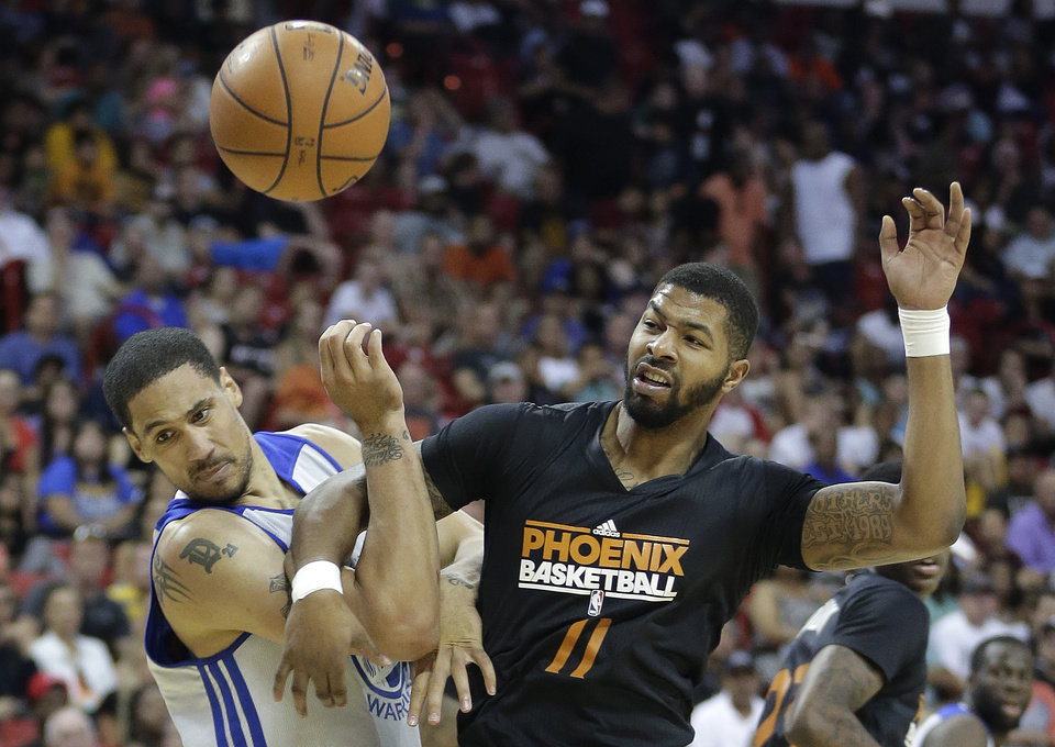 Photo - Golden State Warriors' Dwayne Jones, left, gets tangled up with Phoenix Suns' Markieff Morris battling for a rebound in the first quarter of the NBA Summer League championship game, Monday, July 22, 2013, in Las Vegas. (AP Photo/Julie Jacobson)
