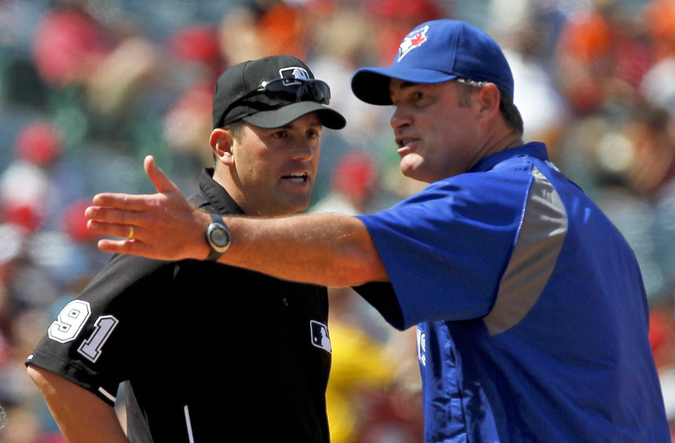 Photo -   Toronto Blue Jays manager John Farrell, right, argues a call with second base umpire Brian Knight during the eighth inning of a baseball game against the Los Angeles Angels in Anaheim, Calif., Sunday, May 6, 2012. The Angels won 4-3. (AP Photo/Chris Carlson)
