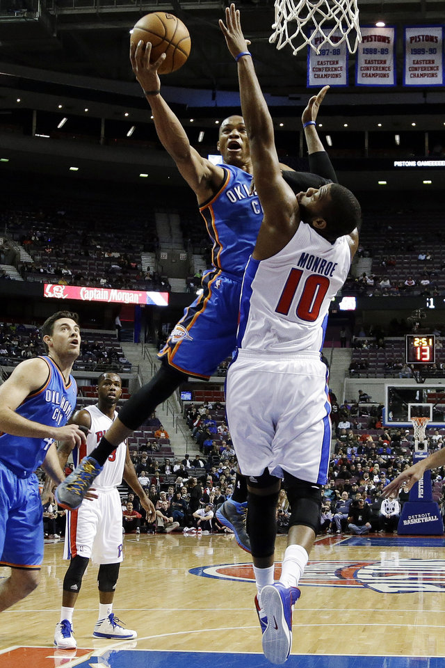Photo - Oklahoma City Thunder guard Russell Westbrook (0) drives on Detroit Pistons center Greg Monroe (10) in the first half of an NBA basketball game in Auburn Hills, Mich., Monday, Nov. 12, 2012. (AP Photo/Paul Sancya) ORG XMIT: MIPS105