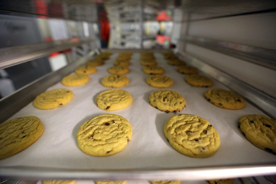 Photo - In this June 19, 2014 photo, freshly baked cannabis-infused cookies cool on a rack inside Sweet Grass Kitchen, a well-established gourmet marijuana edibles bakery which sells its confections to retail outlets, in Denver. Sweet Grass Kitchen, like other cannabis food producers in the state, is held to rigorous health inspection standards, and has received praise from inspectors, according to owner Julie Berliner. (AP Photo/Brennan Linsley)
