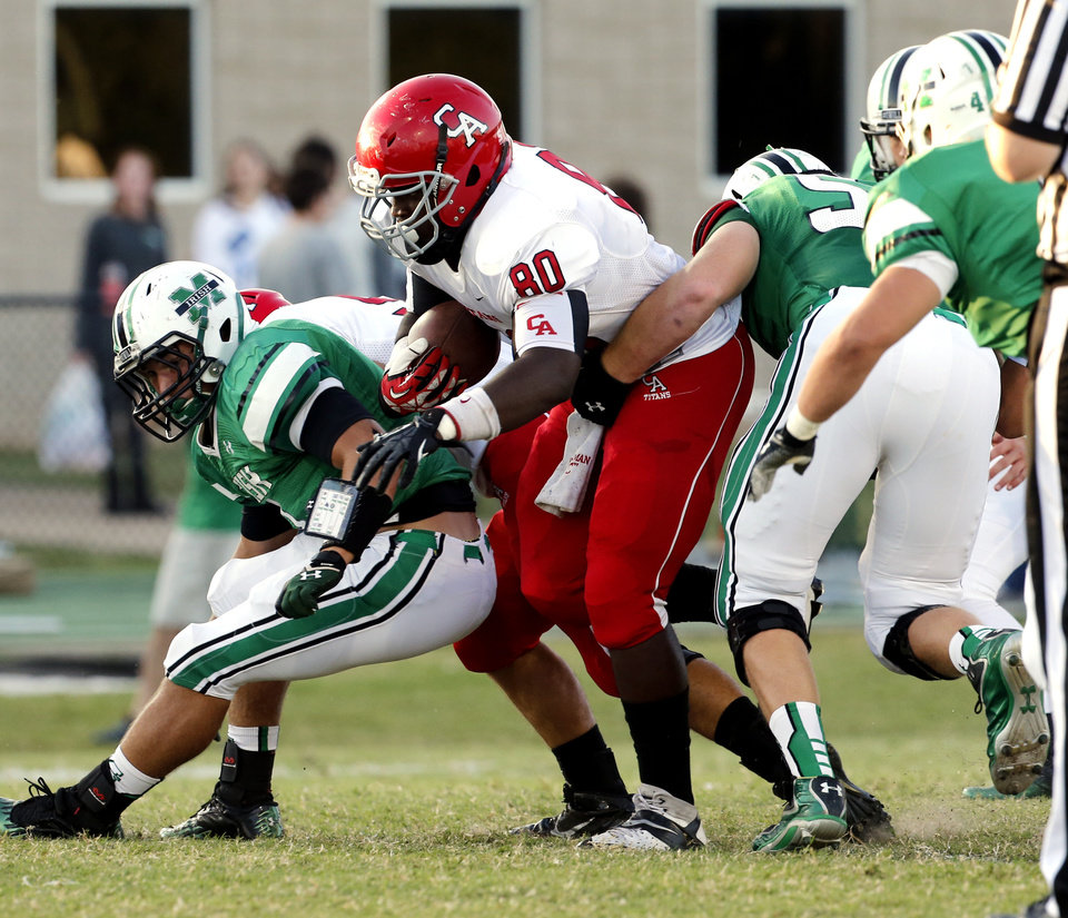Carl Albert's Chantz Woodberry carries the ball in the first half as the Carl Albert Titans play the Bishop McGuinness Irish on Friday, Oct. 4, 2013 in Oklahoma City, Okla.  Photo by Steve Sisney, The Oklahoman