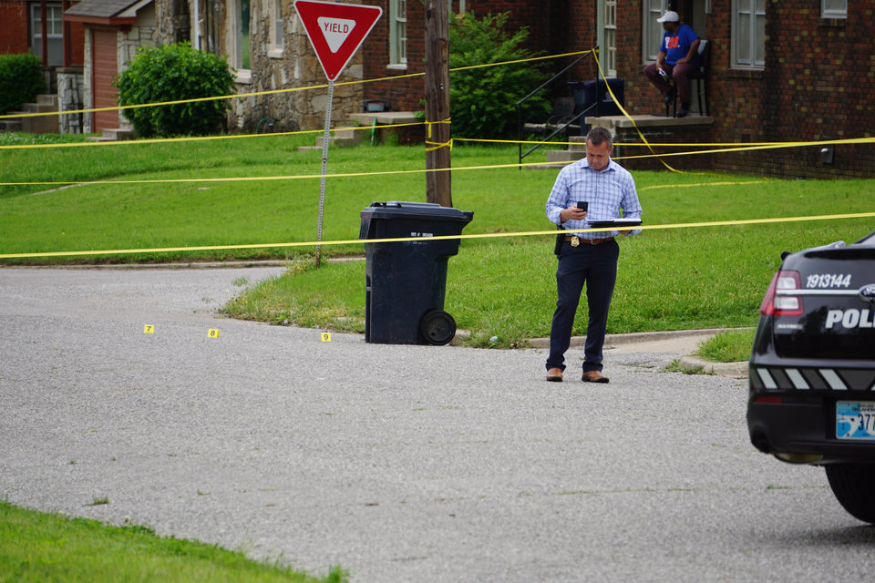 Photo - An Oklahoma City detective at the scene of a fatal shooting in northeast Oklahoma City on Thursday. [Josh Wallace/The Oklahoman]