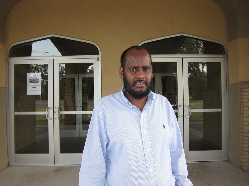 Photo - Imam Hassan Ahmed stands in front of the Grand Mosque of Oklahoma City at 3201 NW 48 in Oklahoma City. Photo by Carla Hinton, The Oklahoman