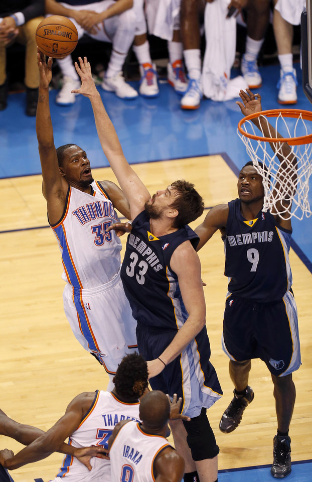 Photo - Oklahoma City's Kevin Durant (35) shoots over Memphis' Marc Gasol (33) as Tony Allen (9)  watches during Game 1 in the first round of the NBA playoffs between the Oklahoma City Thunder and the Memphis Grizzlies at Chesapeake Energy Arena in Oklahoma City, Saturday, April 19, 2014. Photo by Nate Billings, The Oklahoman