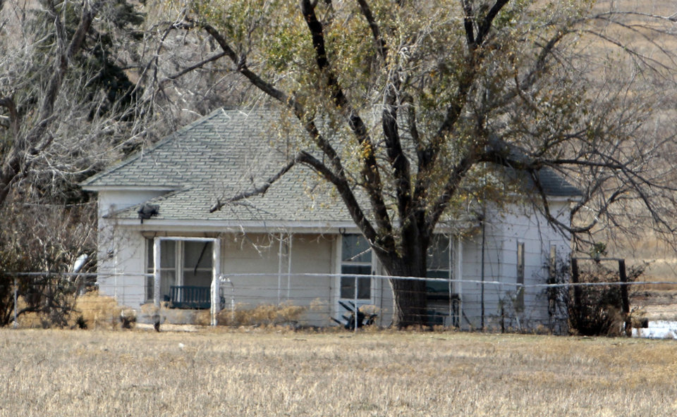 Photo - The house where Chanda Turner died is vacant, and the gate is locked Wednesday in Pauls Valley.  Photos by Steve Sisney, The Oklahoman