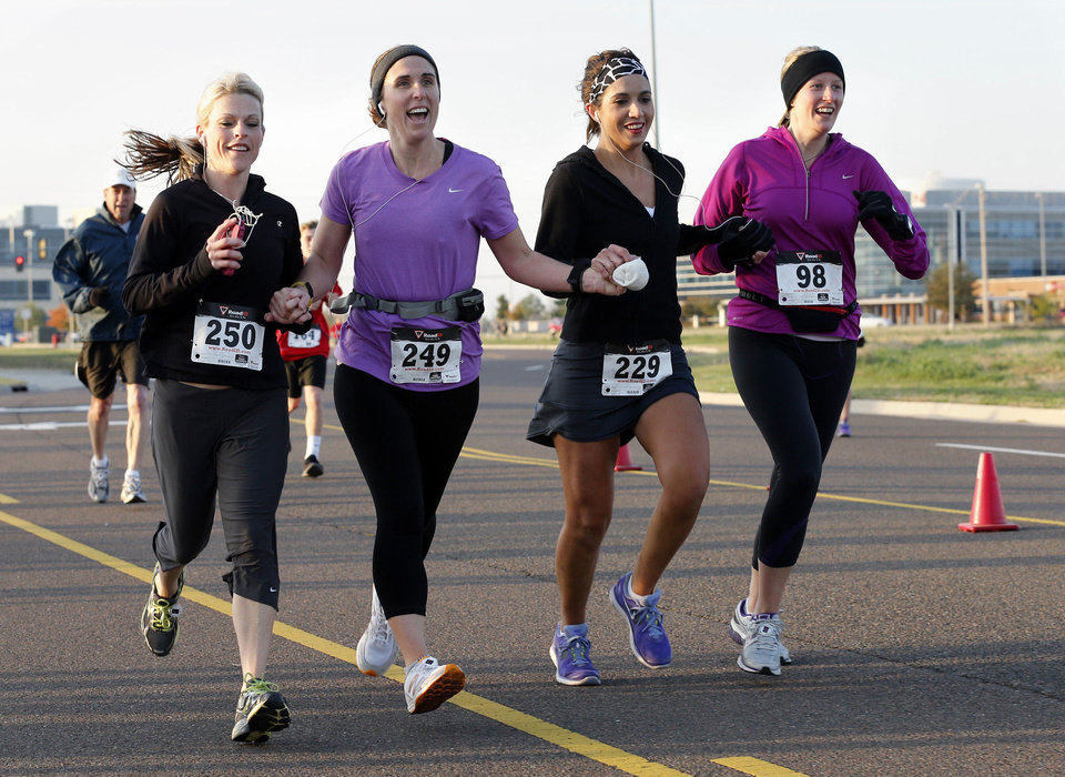 Training partners, from left, Suzanne Brown, Carrie Jankowski, Rhonda Jeffrey and Amanda Lowry approach the finish line in the annual Monster Dash sponsored by Junior League of Norman.  PHOTOS BY STEVE SISNEY, THE OKLAHOMAN