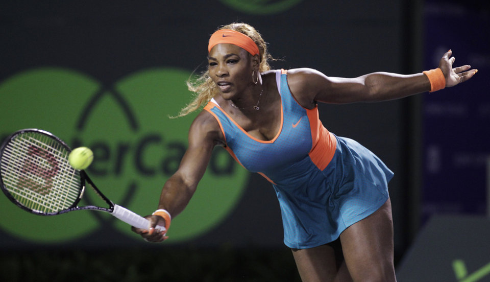 Photo - Serena Williams, of the United States, returns the ball to Angelique Kerber, of Germany, during the Sony Open tennis tournament, Tuesday, March 25, 2014, in Key Biscayne, Fla. (AP Photo/Luis M. Alvarez)