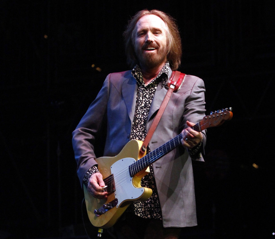 Photo - FILE - In this June 16, 2013 file photo, Tom Petty performs on Day 4 of the 2013 Bonnaroo Music and Arts Festival in Manchester, Tenn. Songwriting has gotten harder, not easier, with time, says Petty, who will receive top honors from the American Society of Composers, Authors and Publishers on Wednesday, April 23, 2014, for his four decades in music.  (Photo by Wade Payne/Invision/AP, file)