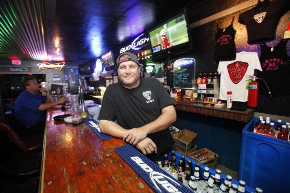 Nathan Cross, shown, manages Grady's 66 Pub in Yukon and is the brother of Grady Cross, guitarist for Cross Canadian Ragweed. <strong>Steve Gooch - THE OKLAHOMAN</strong>