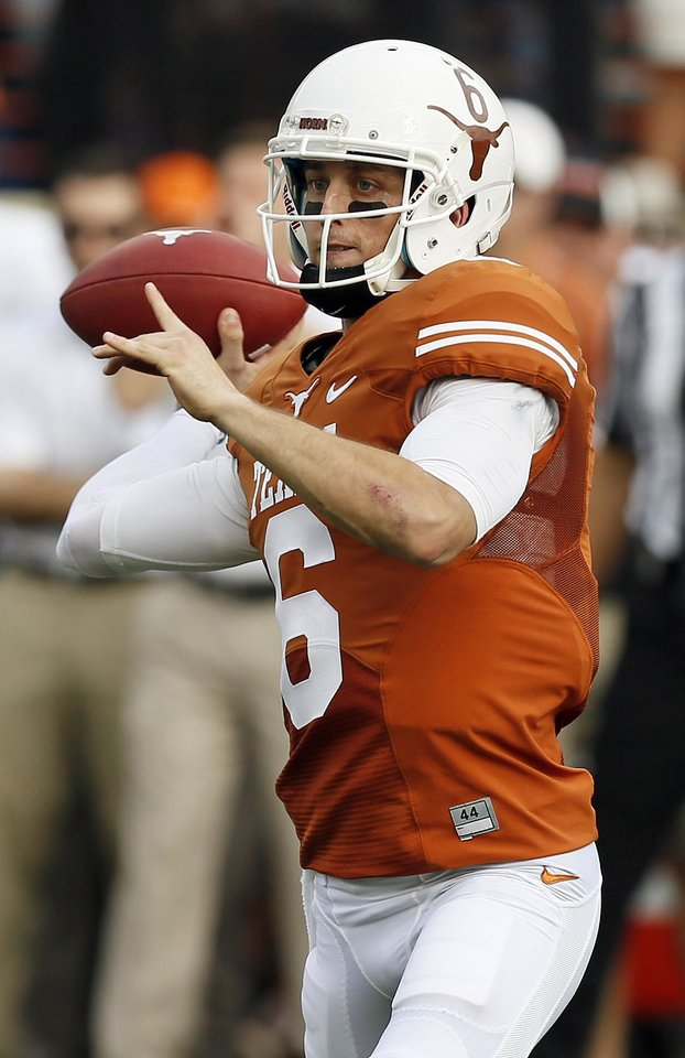UT's Case McCoy (6) passes during a college football game between the Oklahoma State University Cowboys (OSU) and the University of Texas Longhorns (UT) at Darrell K Royal - Texas Memorial Stadium in Austin, Texas, Saturday, Nov. 16, 2013. Photo by Nate Billings, The Oklahoman
