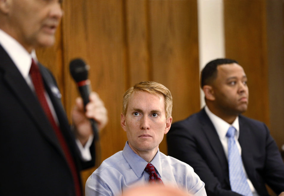 Photo - US Senate candidates from left, Randy Brogdon, James Lankford and T. W. Shannon participate in a debate Wednesday, April 16, 2014. Photo by Jim Beckel, The Oklahoman.