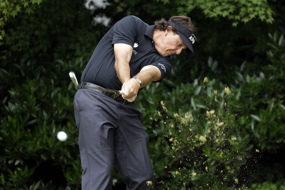Photo - Phil Mickelson tees off on the 11th hole during the first round of the U.S. Open golf tournament at Merion Golf Club, Thursday, June 13, 2013, in Ardmore, Pa. (AP Photo/Morry Gash)