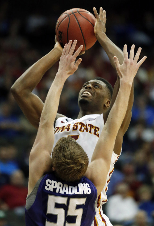 Photo - Iowa State forward Melvin Ejim (3) shoots over Kansas State guard Will Spradling (55) during the second half of an NCAA college basketball game in the quarterfinals of the Big 12 Conference men's tournament in Kansas City, Mo., Thursday, March 13, 2014. Iowa State defeated Kansas State 91-85. (AP Photo/Orlin Wagner)