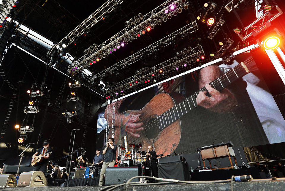 Photo - Willie Nelson performs during the Oklahoma Twister Relief Concert, benefiting victims of the May tornadoes, at Gaylord Family - Oklahoma Memorial Stadium on the campus of the University of Oklahoma in Norman, Okla., Saturday, July 6, 2013. Photo by Nate Billings, The Oklahoman