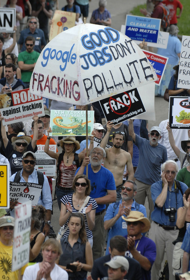 Photo - Protesters rally against fracking at the Capitol in Albany, N.Y., on Monday, June 17, 2013. The demonstrators Monday are urging Gov. Andrew Cuomo to permanently ban hydraulic fracturing for natural gas in New York, saying it will harm the environment. (AP Photo/Tim Roske)