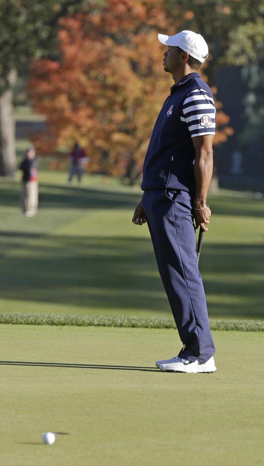 Photo - USA's Tiger Woods reacts after missing a putt on the 16th hole during a singles match at the Ryder Cup PGA golf tournament Sunday, Sept. 30, 2012, at the Medinah Country Club in Medinah, Ill. (AP Photo/Chris Carlson)  ORG XMIT: PGA244