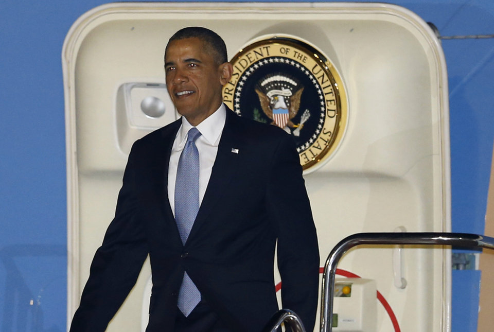 Photo - U.S. President Barack Obama steps down the ramp upon his arrival at Haneda International Airport in Tokyo, Wednesday, April 23, 2014. Obama is in Japan for a three-day state visit. (AP Photo/Shizuo Kambayashi)