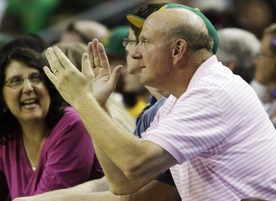 Photo - FILE - In this July 23, 2011 file photo, Microsoft Corp. CEO Steve Ballmer cheers during a charity basketball game in Seattle. For decades, Steve Ballmer has been Microsoft's biggest cheerleader with his big, booming voice and energetic high-fives, which are famous around Seattle. Now that he's agreed to buy the Los Angeles Clippers for $2 billion, the former CEO of the technology giant is expected to bring that boosterism to the hardwood down south. (AP Photo/Ted S. Warren, File)