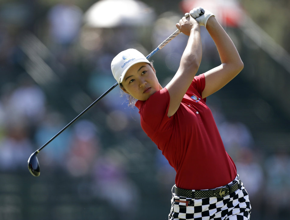 Photo - Minjee Lee, of Australia, watches her tee shot on the 13th hole during the second round of the U.S. Women's Open golf tournament in Pinehurst, N.C., Friday, June 20, 2014. (AP Photo/Bob Leverone)