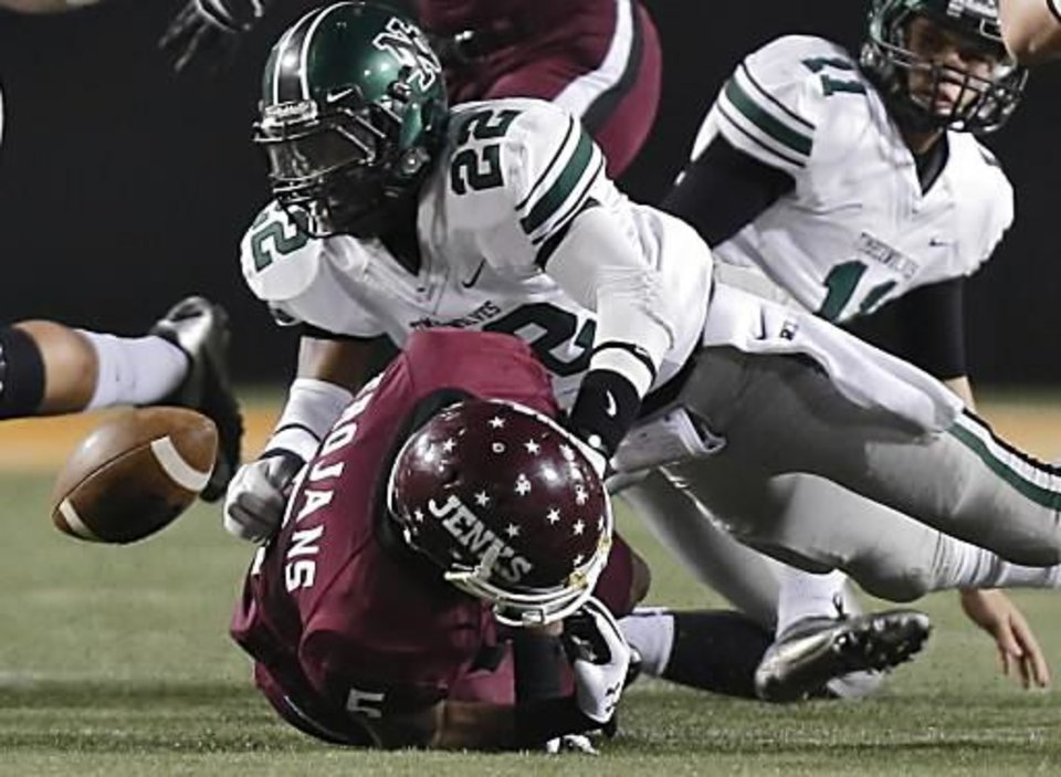 Norman North\'s Adim Chukwurah (22) forces a fumble on Jenks\' Trey\'Vonne Barr\'e (5) during the Class 6A Oklahoma state championship football game between Norman North High School and Jenks High School at Boone Pickens Stadium on Friday, Nov. 30, 2012, in Stillwater, Okla. Photo by Chris Landsberger, The Oklahoman