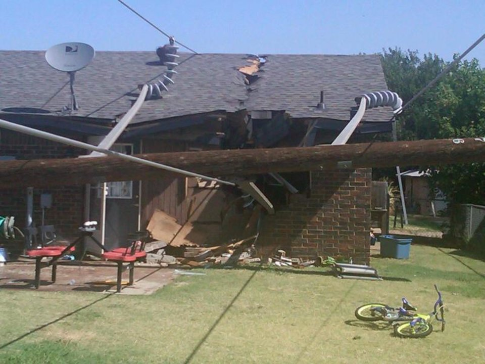 Photo - This house was severly damaged as the transmission pole and lines are on the floor in the house at Cleveland and Lisa in Waukomis. Photo by Mike Honigsberg, Emergency Management Director for Enid and Garfield County