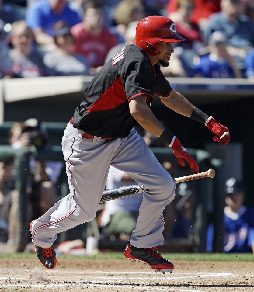 Photo - Cincinnati Reds' Billy Hamilton bunts for a hit during a spring exhibition baseball game against the Texas Rangers, Monday, March 10, 2014, in Suprise, Ariz. (AP Photo/Darron Cummings)