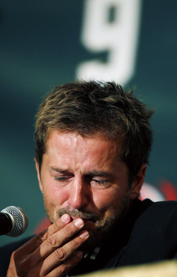 Photo - FILE -  In this Sept. 23, 2011 file photo NHL hockey player Mike Modano gets choked up during a news conference announcing his retirement in Dallas. Modano had several tearful farewells as his playing days wound down. The guy who made hockey cool in Dallas figures he'll get emotional again for the final ceremony: retiring his iconic No. 9 during the  Dallas Stars' game against Minnesota on Saturday, March 8. (AP Photo/LM Otero, File)