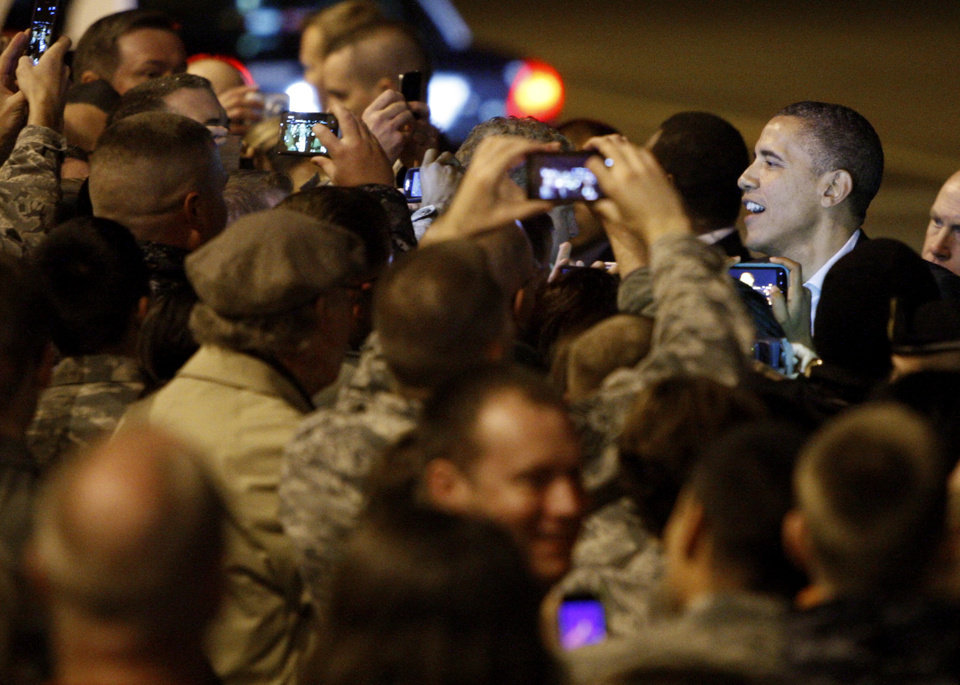 President Barack Obama greets military and civilian personal from Tinker Air Force Base after exiting Air Force One at Tinker Air Force Base in Midwest City, Wednesday, March 21, 2012. President Obama is in town for a visit to Cushing, Okla., on Thursday. Photo by Bryan Terry, The Oklahoman